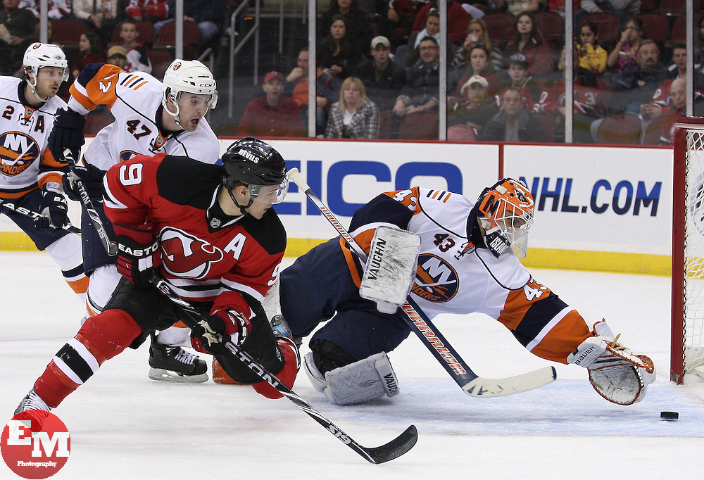 Apr 10, 2010; Newark, NJ, USA; New Jersey Devils left wing Zach Parise (9) scores a goal on New York Islanders goalie Martin Biron (43) during the first period at the Prudential Center.