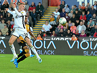 Football - 2019 / 2020 EFL Carabao (League) Cup - Second Round: Swansea City vs. Cambridge United<br /> <br /> Sam Surridge of Swansea City heads at goal, at Liberty Stadium.<br /> <br /> COLORSPORT/WINSTON BYNORTH
