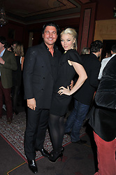 TAMARA BECKWITH and GIORGIO VERONI at the 39th birthday party for Nick Candy in association with Ciroc Vodka held at 5 Cavindish Square, London on 21st Januatu 2012.