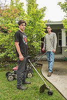 """I work for my dad but eventually I want to go off the grid.""  Donnie McMahon and his younger brother, Jackson, finish up a lawn at the corner of Berry and Myrtle Street in Calistoga."
