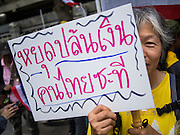 03 SEPTEMBER 2013 - BANGKOK, THAILAND:  A woman protesting the price of cooking gas in front of Government House Tuesday. The Thai government raised the price of Liquified Propane Gas (LPG - cooking gas) by 50 satang per kilogram (about 1.5 cents US) over the weekend. The price of electricity and highway tolls also went up on the same day dealing most Thais a triple blow. The Thai consumers foundation has filed a suit in Thai administrative courts to block the increase but the courts have not yet ruled on the case. About 50 people protested the price hike at Government House in Bangkok and delivered a letter outlining their objections to a representative of the Prime Minister.   PHOTO BY JACK KURTZ