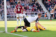 Adam Rooney (9) collides with David Cornell (1) during the EFL Sky Bet League 2 match between Northampton Town and Salford City at the PTS Academy Stadium, Northampton, England on 19 October 2019.