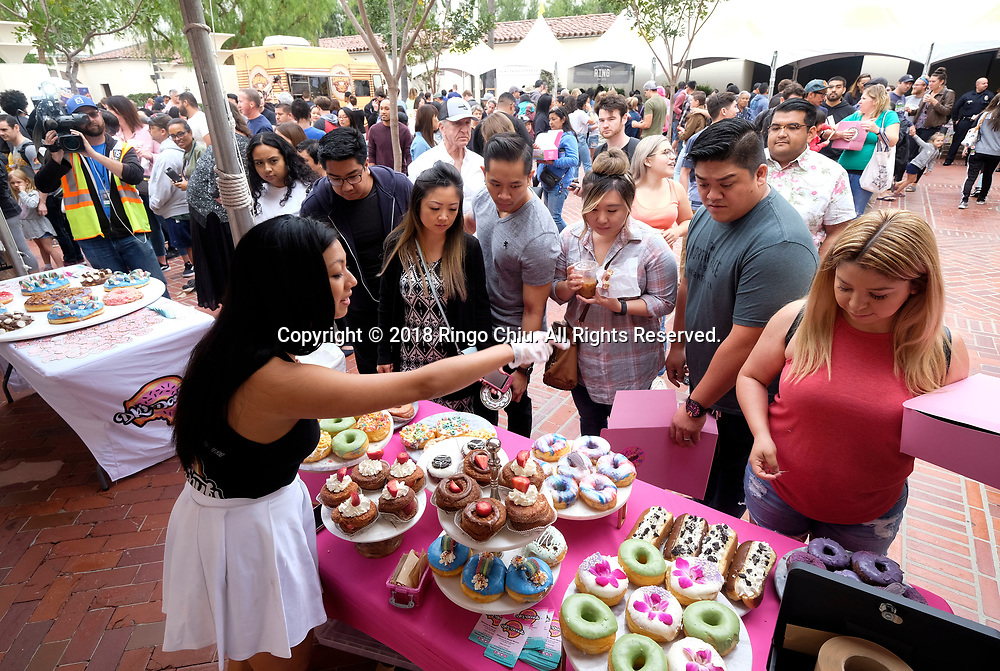People line for donuts at the inaugural DTLA Donut Festival at Union Station in Los Angeles on Saturday, June 16, 2018. (Photo by Ringo Chiu)<br /> <br /> Usage Notes: This content is intended for editorial use only. For other uses, additional clearances may be required.