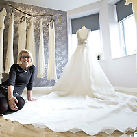 Picture Christian Cooksey. Shopping Times. Unbridaled, 2 Somerset Road, Ayr. Pictured is owner Emily Plunkett in her bridal shop with her dresses.