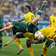 GRENOBLE, FRANCE June 18.  Caitlin Foord #9 of Australia goes over the top of Konya Plummer #5 of Jamaica as she challenges for a cross during the Jamaica V Australia, Group C match at the FIFA Women's World Cup at Stade des Alpes on June 18th 2019 in Grenoble, France. (Photo by Tim Clayton/Corbis via Getty Images)