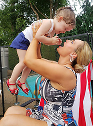 """Coco Austin releases a photo on Twitter with the following caption: """"""""Love me some BBQ&#39;s!!<br /> 4th of July with friends was relaxing and fun. Chanel played &amp; played til she could no more &amp; passed out.She is addicted to the pool. I wore matching spider man dresses w/ my sis because of the holiday colors.I was wondering when I was gonna bring mine out ha"""""""". Photo Credit: Twitter *** No USA Distribution *** For Editorial Use Only *** Not to be Published in Books or Photo Books ***  Please note: Fees charged by the agency are for the agency's services only, and do not, nor are they intended to, convey to the user any ownership of Copyright or License in the material. The agency does not claim any ownership including but not limited to Copyright or License in the attached material. By publishing this material you expressly agree to indemnify and to hold the agency and its directors, shareholders and employees harmless from any loss, claims, damages, demands, expenses (including legal fees), or any causes of action or allegation against the agency arising out of or connected in any way with publication of the material."""