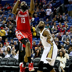 Jan 25, 2016; New Orleans, LA, USA; Houston Rockets guard James Harden (13) drives in for a lay up past New Orleans Pelicans guard Tyreke Evans (1) during the first quarter of a game at the Smoothie King Center. Mandatory Credit: Derick E. Hingle-USA TODAY Sports