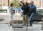 © Licensed to London News Pictures. 29/08/2014. Clacton-on-Sea, UK. Members of the media use a bench as a vantage point.  Douglas Carswell and Nigel Farage, Leader of the UK Independence Party, UKIP, meet local people on a walk about in Clacton-on-Sea today 29th August 2014. Tory Douglas Carswell  defected to UKIP and quit as MP for Clacton, saying he will contest the subsequent by-election for Nigel Farage's party.. Photo credit : Stephen Simpson/LNP