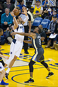 Golden State Warriors forward Andre Iguodala (9) defends Dallas Mavericks center Salah Mejri (50) at Oracle Arena in Oakland, California, on February 8, 2018. (Stan Olszewski/Special to S.F. Examiner)