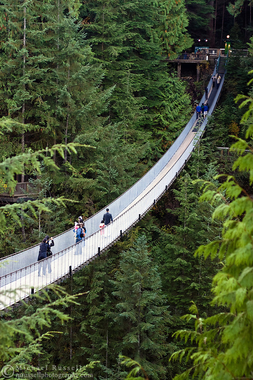 Tourists cross the Capilano Suspension Bridge over the Capilano River in North Vancouver..