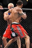 "ATLANTA, GEORGIA, SEPTEMBER 6, 2008: Ryo Chonan (facing) fails to block a punch from Roan Carneiro during ""UFC 88: Breakthrough"" inside Philips Arena in Atlanta, Georgia on September 6, 2008"