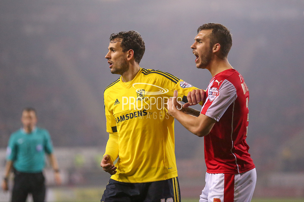 Middlesbrough forward Christian Stuani (18) and Rotherham United defender Joe Mattock (3)  during the Sky Bet Championship match between Rotherham United and Middlesbrough at the New York Stadium, Rotherham, England on 8 March 2016. Photo by Simon Davies.
