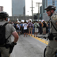 Bike police officers watch participants during a parade prior to the Republican National Convention in Tampa, Fla. on Wednesday, August 29, 2012. (AP Photo/Alex Menendez)