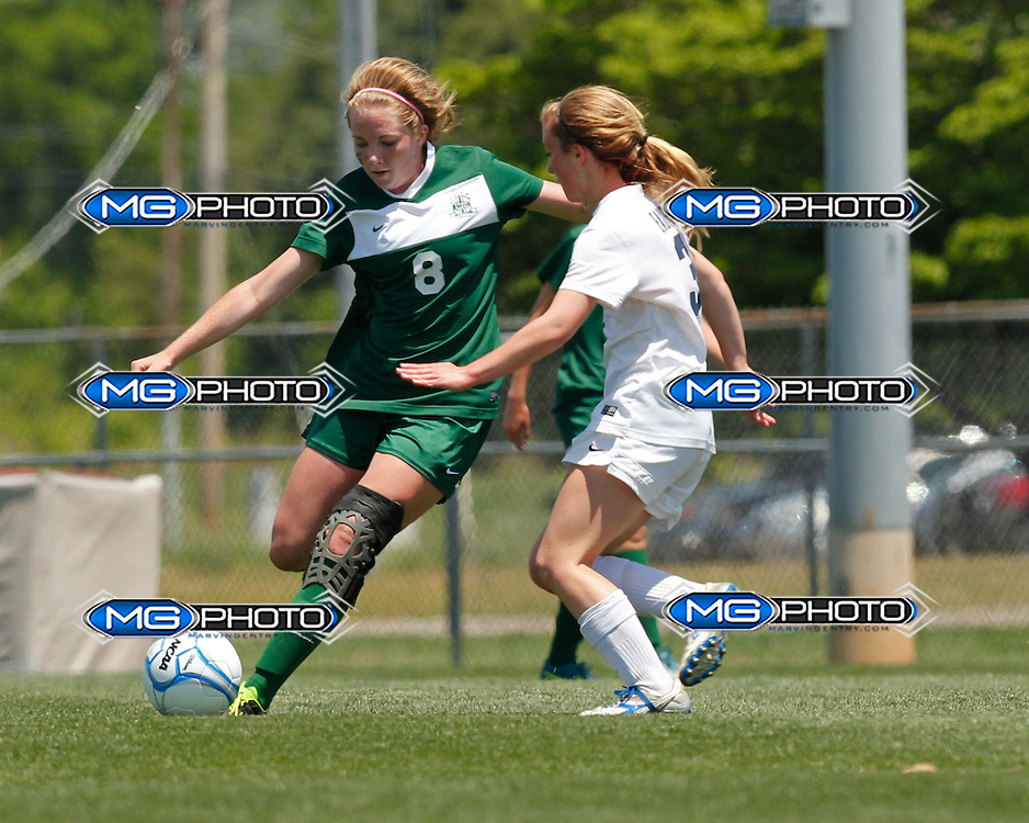 May 10, 2014; Huntsville, AL, USA; Mountain Brook Anna Catherine Gillespy (8) kicks the ball as Oak Mountain Trinity Charlotte Prater (3) defends during the 6A State Girls Soccer Championship at John Hunt Soccer Complex. Mandatory Credit: Marvin Gentry