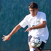 Golden West center back Brian Montano (28) drives a crossing ball in Golden West's  1-0 win over Fullerton College.