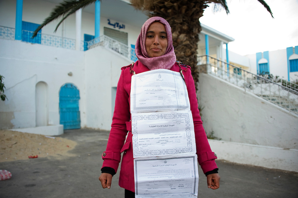 January 2016, Kasserine, Tunisia. One of the protesters who squatted the regional headquarters of the Kasserine Governate two weeks ago to ask for employment shows her diplomas. Since three days the protesters have begun an hunger strike.