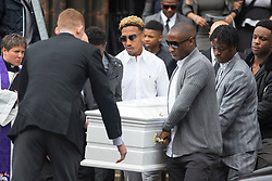 © Licensed to London News Pictures. 21/04/2017. Leeds UK. Leeds United footballer Malik Wilks (white shirt & sunglasses) acts as a Pallbearer at his brother Raheem Wilks' funeral that is taking place today at St Aidan's church in Leeds. Raheem who is the brother of Leeds United footballer Malik Wilks died as a result of a single gunshot wound to the chest outside a barber shop on Gathorn Terrace in the Harehills area of Leeds in January. Photo credit: Andrew McCaren/LNP