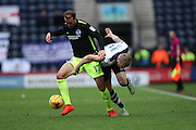 Brighton & Hove Albion centre forward Glenn Murray (17) out muscles Preston North End defender Ton Clarke (5) during the EFL Sky Bet Championship match between Preston North End and Brighton and Hove Albion at Deepdale, Preston, England on 14 January 2017.