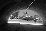 France. Paris. 5th district. under the pont de la Tournelle  , Notre Dame Cathedrale in the distance