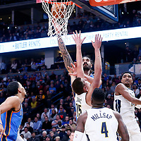 09 November 2017: Oklahoma City Thunder center Steven Adams (12) goes for the layup over Denver Nuggets center Nikola Jokic (15) during the Denver Nuggets 102-94 victory over the Oklahoma City Thunder, at the Pepsi Center, Denver, Colorado, USA.