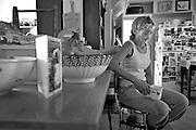 Robin Schieffer takes a break after chores, Tuesday, Aug. 7, 2012, at Schieffer family farm in Berthoud..(Matthew Jonas/Times-Call)