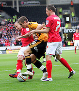 Hull Saturday september 18th, 2010: Tom Cairney of Hull City holding up the ball against the Nottingham Forrest defence during the NPower Championship Match at the KC Stadium,Hull. (Pic by Darren Walker/Focus Images)..