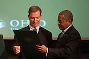 Ohio University President Roderick McDavis presents the 2014 Distinguished Professor Award to Dr. Christopher France, just before unveiling his portrait in Baker University Center Ballroom on Tuesday, March 10.