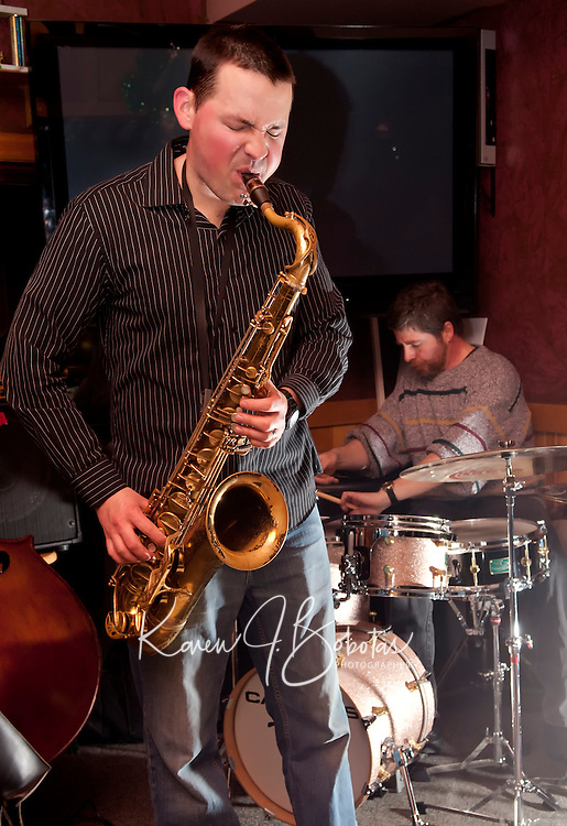 Jonathan Lorentz plays a bit of jazz with Tim Gilmore on drums and John Hunter on bass at Patrick's Pub and Eatery on Tuesday evening.  (Karen Bobotas/for the Laconia Daily Sun)