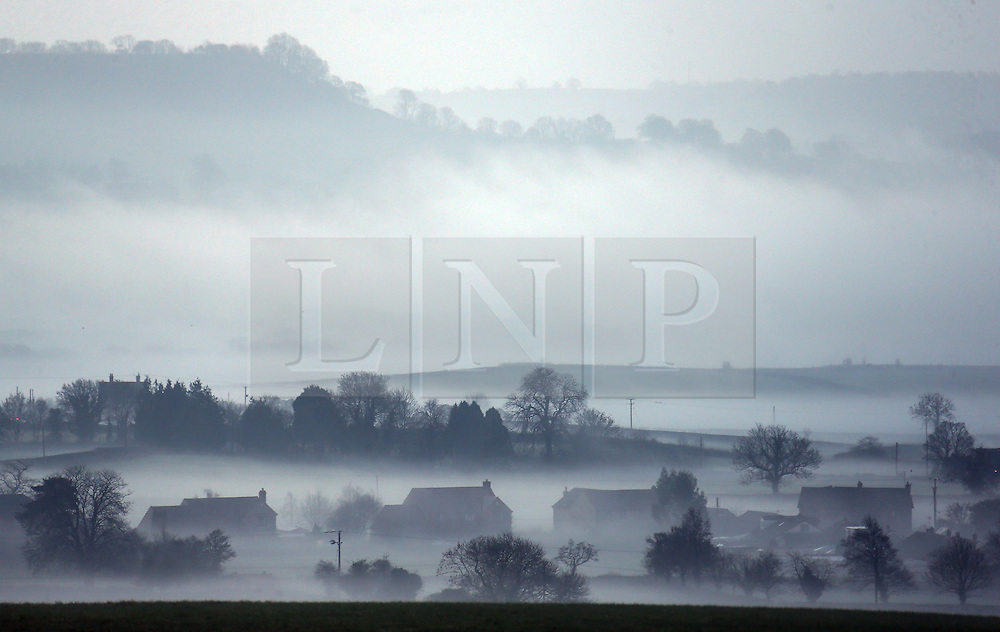 © Licensed to London News Pictures. 22/01/2014. Somerset, UK Mid Somerset shrouded in mist this morning 22 January 2014. Photo credit : Jason Bryant/LNP