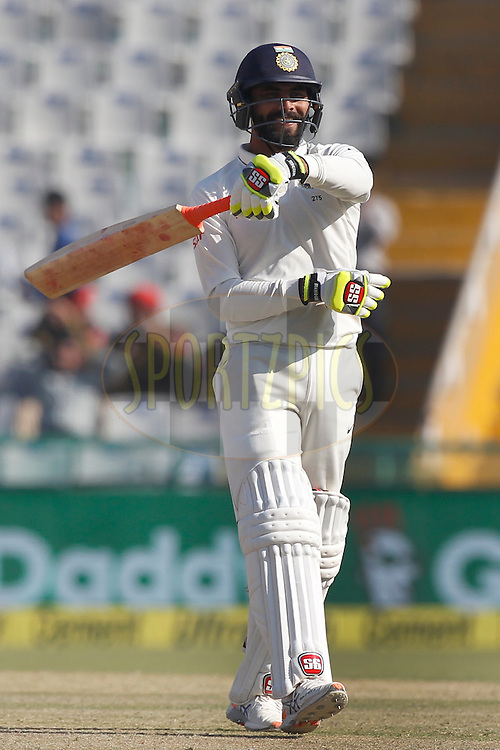 Ravindra Jadeja of India unfurls his trademark bat-twirling celebration scoring half century during day 3 of the third test match between India and England held at the Punjab Cricket Association IS Bindra Stadium, Mohali on the 28th November 2016.<br /> <br /> Photo by: Deepak Malik/ BCCI/ SPORTZPICS