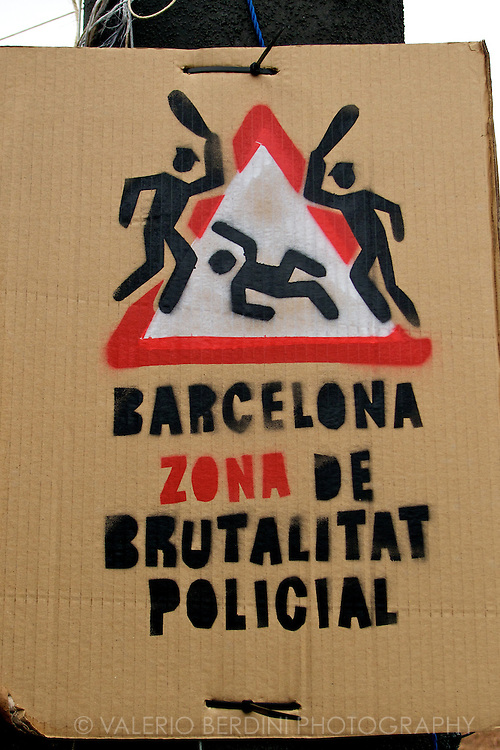 A banner referring to the riots between the indignados and the police.