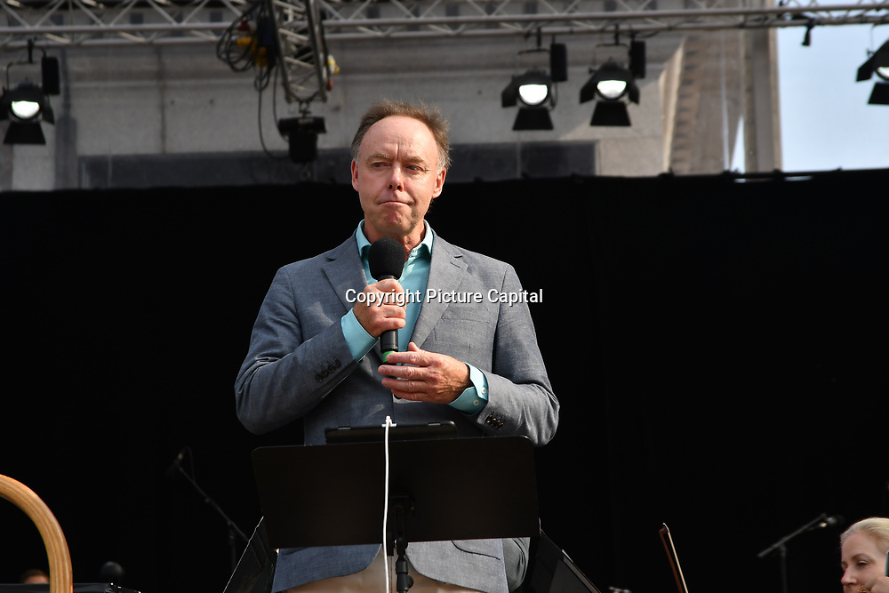 Speaker Ian Robertson at the BMW Classics + live streamed on YouTube in Trafalgar Square on a hot weather in London, UK on July 1st 2018.