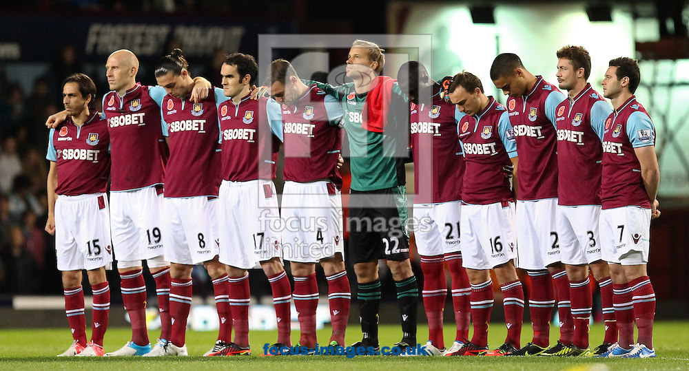 Picture by John  Rainford/Focus Images Ltd +44 7506 538356.03/11/2012.West Ham United players observe a minutes silence before kick-off against  Manchester City in the Barclays Premier League match at the Boleyn Ground, London.