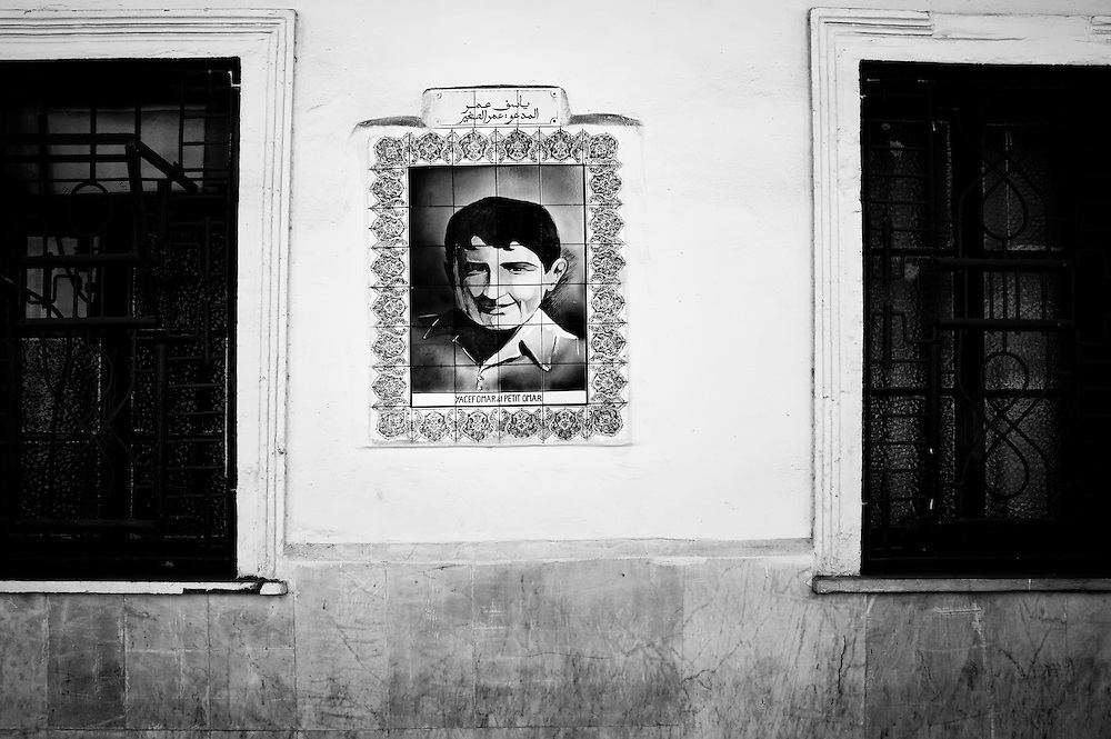 "Algiers May 2012. A portrait of Yacef Omar named ""le Petit Omar"" on the wall of police station in rue Angkor, Algiers. Born in the Casbah, Yacef Saadi's nephew Omar  died during the battle of Algiers with Ali La pointe and Hassiba Ben Bouali in 1957 when French forces bombed their hideout in the Casbah of Algiers."