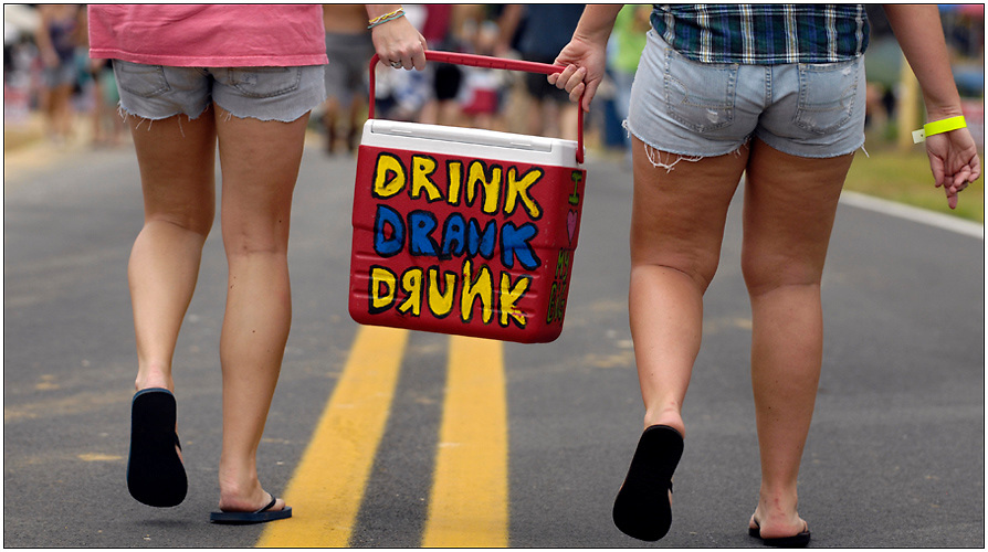 EAST DUBLIN, GA - JULY 10: Coolers are allowed and drinking is encouraged during the 14th Annual Summer Redneck Games July 10, 2010 in East Dublin, Georgia. The games started as a charity in 1996 and as a spoof for the summer Olympics held in Atlanta that year. (Photo by Stephen Morton/Getty Images)