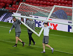 MANCHESTER, ENGLAND - Wednesday, March 16, 2016: Liverpool's James Milner helps carry the goal during a training session at Old Trafford ahead of the UEFA Europa League Round of 16 2nd Leg match against Manchester United. (Pic by David Rawcliffe/Propaganda)