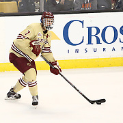 Isaac MacLeod #7 of the Boston College Eagles looks to pass the puck during The Beanpot Championship Game at TD Garden on February 10, 2014 in Boston, Massachusetts. (Photo by Elan Kawesch)