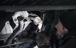 THEMENBILD - ein Mechaniker kontrolliert nach seinen Schweissarbeiten die Auspuffanlage an einem Kraftfahrzeug in einer KFZ- Werkstaette, aufgenommen am 13. Februar 2015, Maishofen, Österreich // a mechanic checked after his welding works the exhaust system of a motor vehicle in a car Raipair Shop, Maishofen, Salzburg, Austria on 2015/02/13, Austria. EXPA Pictures © 2015, PhotoCredit: EXPA/ JFK