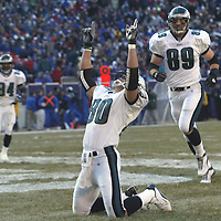 (SPORTS) East Rutherford 12/28/2002     The Eagles # 80 James Thrash  celebrates the only Eagles touchdown of the game.  Behind # 89 Chad Lewis and 84 Freddie Mitchell      Photo by Michael J. Treola Staff Photogrpaher.     MJT