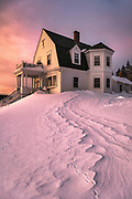 A winding snow drift points the way to the Keeper's House at Marshall Point after a strong winter storm. The light was downright strange on this evening as the sun set through a layer of clouds.