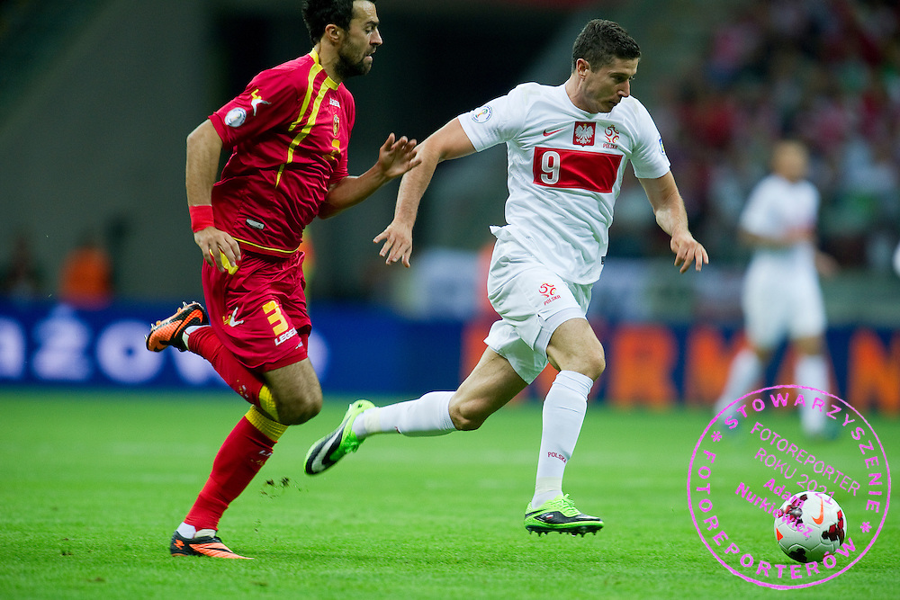 (R) Poland's Robert Lewandowski fights for the ball with (L) Montenegro's Marko Basa during the 2014 World Cup Qualifying Group H football match between Poland and Montenegro at National Stadium in Warsaw on September 06, 2013.<br /> <br /> Poland, Warsaw, September 06, 2013<br /> <br /> Picture also available in RAW (NEF) or TIFF format on special request.<br /> <br /> For editorial use only. Any commercial or promotional use requires permission.<br /> <br /> Mandatory credit:<br /> Photo by &copy; Adam Nurkiewicz / Mediasport