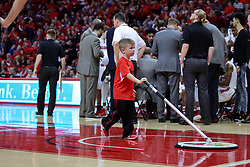 11 February 2017:  Redbird Ball Crew tidies up the floor during a College MVC (Missouri Valley conference) mens basketball game between the Bradley Braves and Illinois State Redbirds in  Redbird Arena, Normal IL