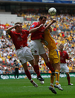 Photo: Steve Bond/Richard Lane Photography. <br />Ebbsfleet United v Torquay United. The FA Carlsberg Trophy Final. 10/05/2008. Tim Sills (R) is beaten in the air by Peter Hawkins (C)