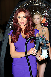 Amy Childs photocall before (Failed)  Guinness World Record Attempt of the most people being spray tanned at the same time....at the Professional Beauty Show, Excel, London, UK, February 25, 2013.  Photo by Chris Joseph / i-Images.