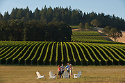 Couples enjoying wine tasting at Stoller Vineyards, Dundee Hills, Willamette Valley, Oregon.
