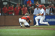 Louisiana-Lafayette's Seth Harrison (27) scores as the ball comes out of the mitt of Mississippi's Will Allen (30) in an NCAA Super Regional game in Lafayette, La. on Sunday, June 8, 2014. Mississippi won 5-2. (AP Photo/Oxford Eagle, Bruce Newman)