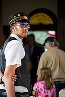 Asst Conductor James Nigzus awaits the arrival of the 12 o'clock train at the Laconia Train Station during the 125th anniversary celebration on Saturday.  (Karen Bobotas/for the Laconia Daily Sun)