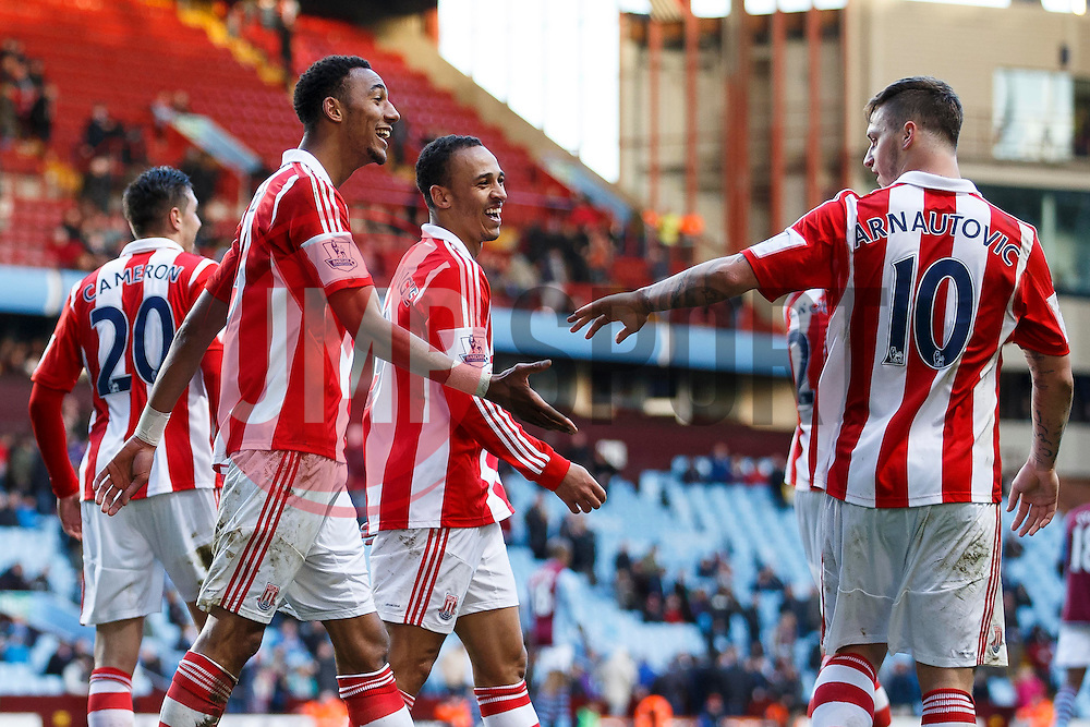 Stoke Midfielder Steven N'Zonzi (FRA) and Forward Peter Odemwingie (NGA) are all smiles after Defender Geoff Cameron (USA) scores to give their side a 4-1 lead - Photo mandatory by-line: Rogan Thomson/JMP - 07966 386802 - 23/03/2014 - SPORT - FOOTBALL - Villa Park, Birmingham - Aston Villa v Stoke City - Barclays Premier League.