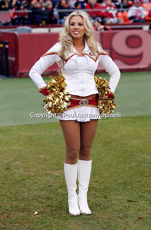 A San Francisco 49ers cheerleader smiles during the NFL week 17 football game against the Arizona Cardinals on Sunday, January 2, 2011 in San Francisco, California. The 49ers won the game 38-7. (©Paul Anthony Spinelli)