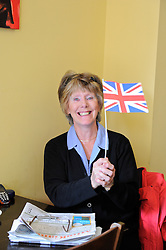 Brighton, UK. 29/04/2011. The Royal Wedding of HRH Prince William to Kate Middleton. Royl flag waver in a cafe in Brighton. Photo credit should read: Peter Webb/LNP. Please see special instructions for licensing information. © under license to London News Pictures